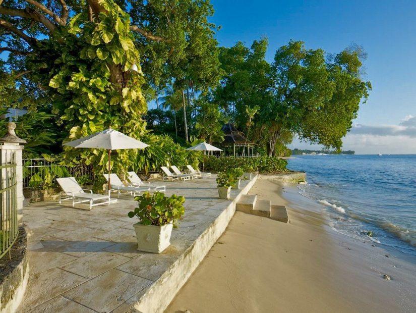 The sun deck at Mango Bay villa directly abuts the beach