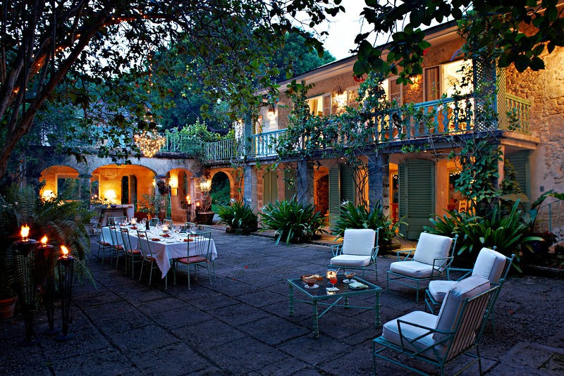 Fustic house, holiday rental barbados extraordinaire, vine covered courtyard and outdoor dining area