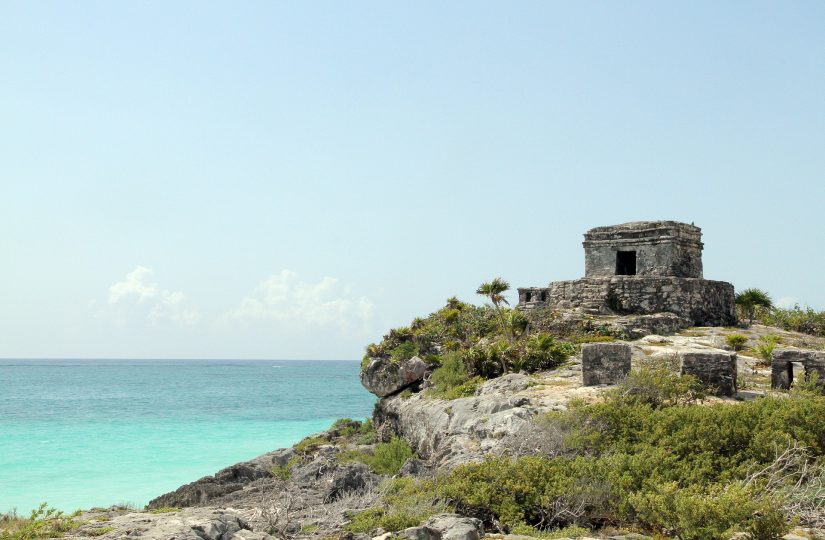 The Tulum Ruins are perched overlooking the turquoise waters along Mexico's prestigious coastline