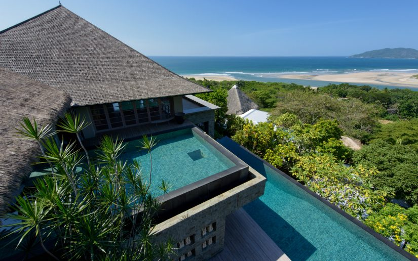 Elevated view of Alang Alang, its rooftop pool and the beautiful surrounding tropical forest.