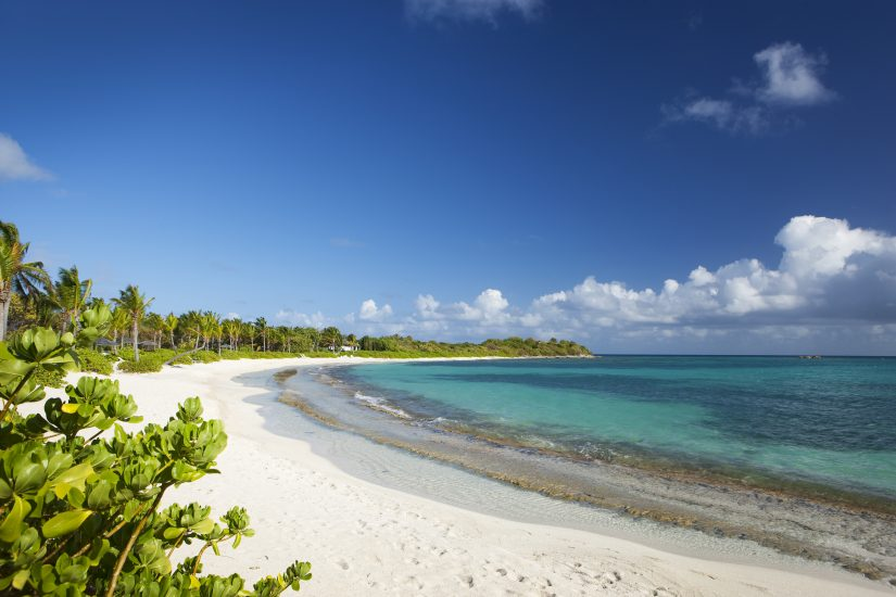 Explore the natural white sandy beaches, one of the best Antigua things to do