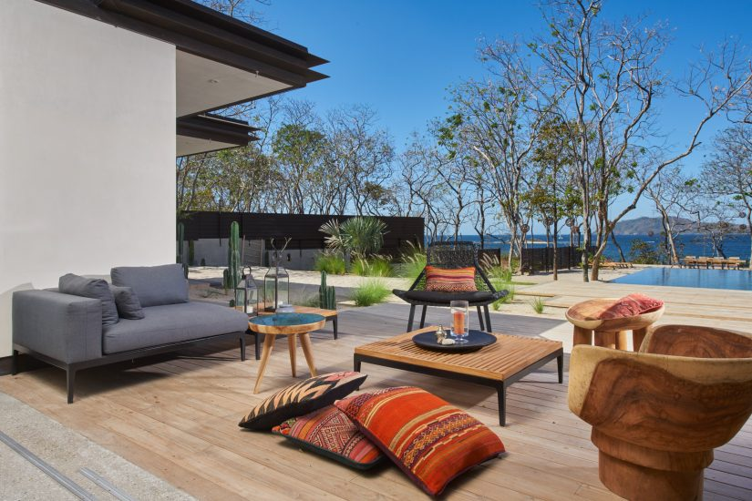 The outdoor sitting area at Morazeba luxury villa in Costa Rica is stylish, comfortable, and placed in the middle of a huge amount of scenic grandeur