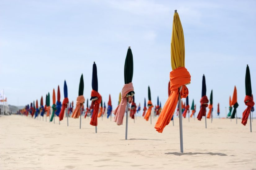 Lined in colorful parasols, Deauville is one of the best beaches in northern France