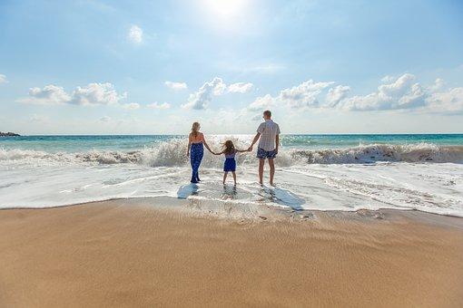 Family enjoying their beach day