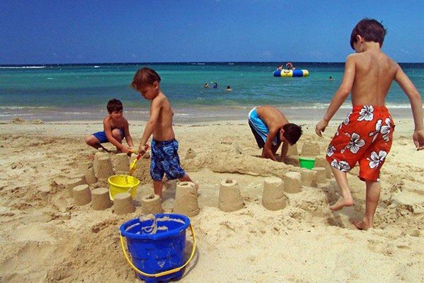 kids making sandcastles at jamaica resort