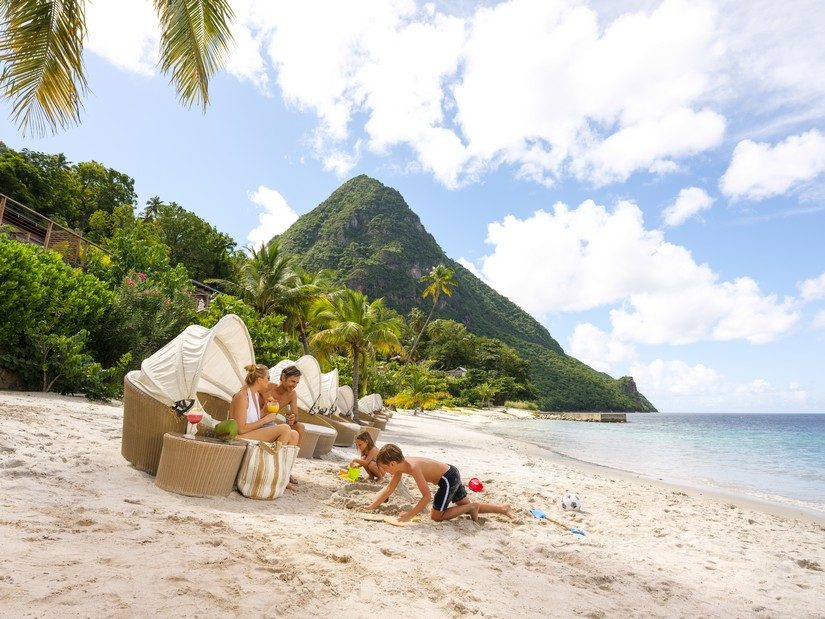 Kids playing on the beach at Sugar Beach Resort in St Lucia