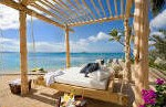 The floating divan on the beach at the BVI rental villa Aquamare on Mahoe Bay