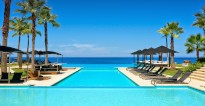 View across the massive swimming pool of The Golden Shell villa at Eden Rock resort in the Dominican Republic