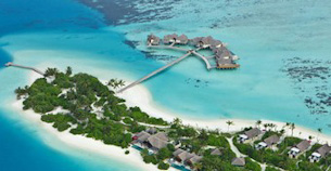 Aerial view of an over-water-villa resort in the Maldives