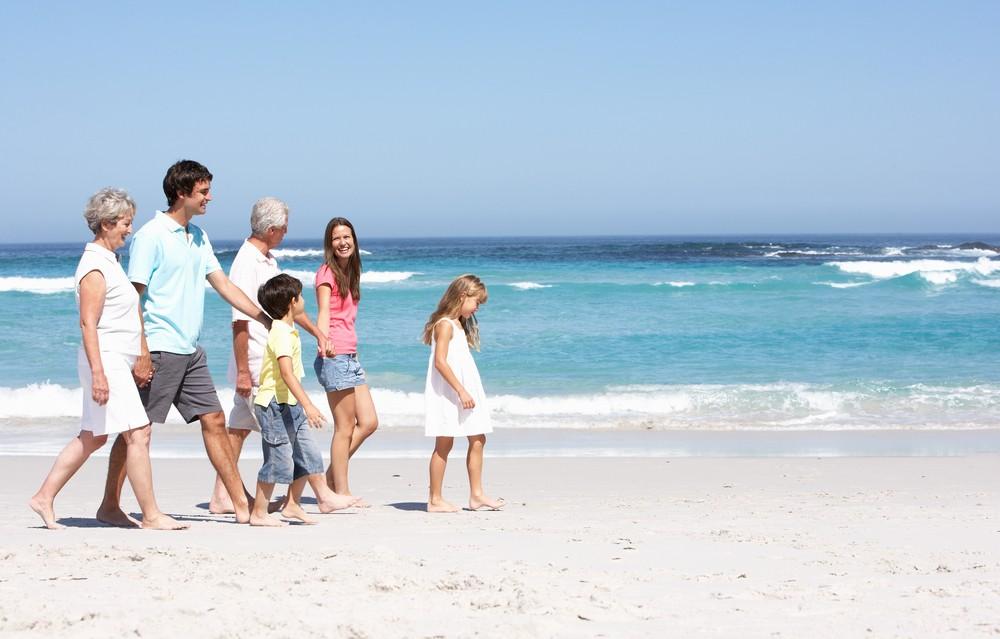 A family having fun on the beach at choc bay