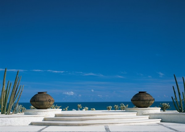 View of the ocean from across the patio of a Mexican Villa
