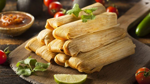A pile of hugely appetizing banana-wrapped Costa Rican Tamal