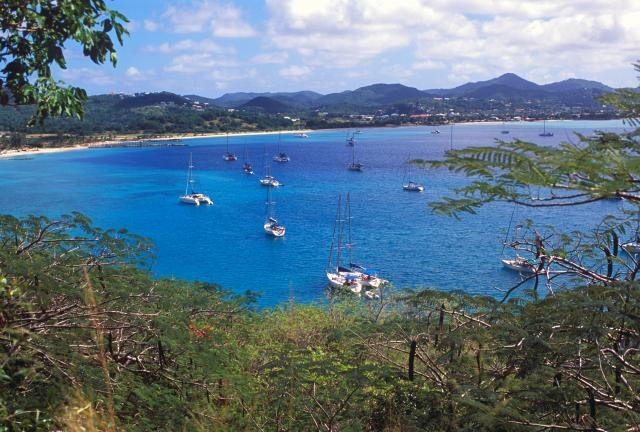 St Lucia is popular for sea water sports such as yachting; here we see a bay filled with yachts ready to explore the seas