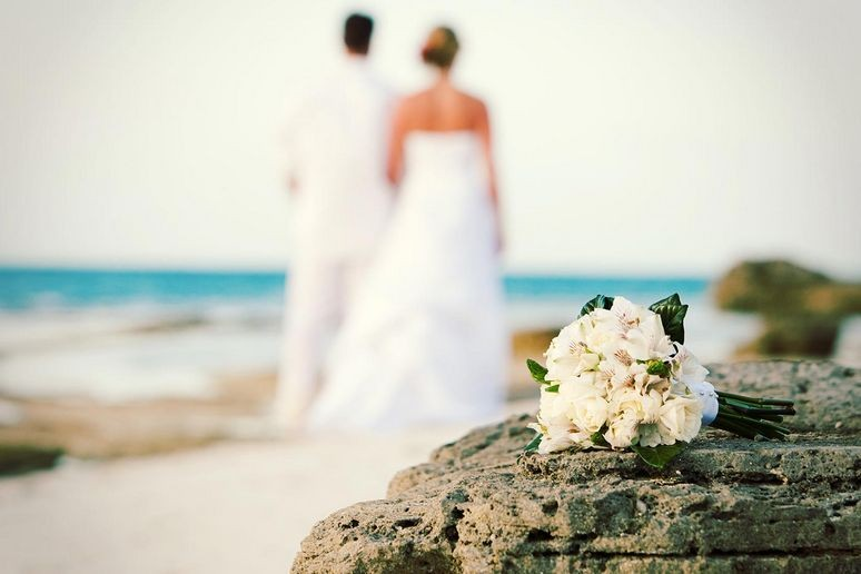 A couple getting married on grace bay beach
