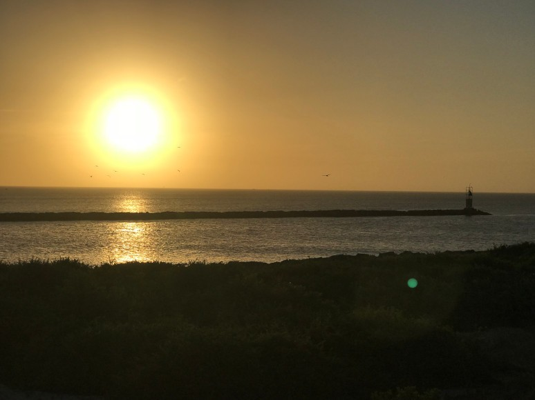 The Sun Sets over the sea at the Hamptons