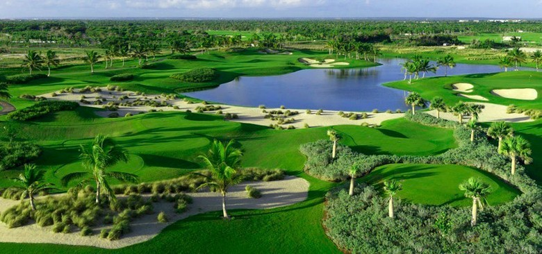 View of the Corales golf course at Punta Cana in the Dominican Republic - coastal views, tropical trees, and a course that can challenge players of all abilities