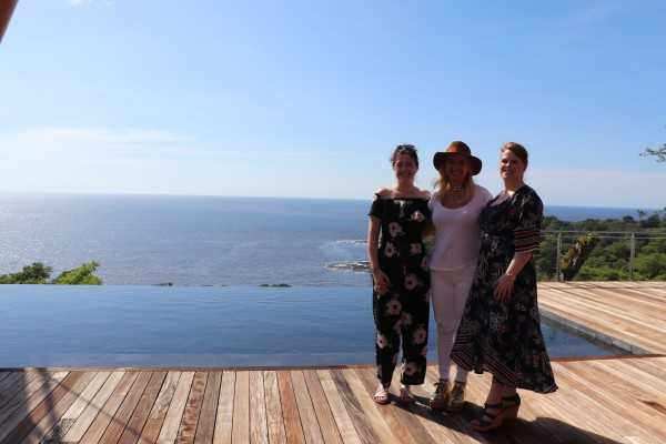 The Exceptional Villas Team by the pool in Cielo Mar Villa