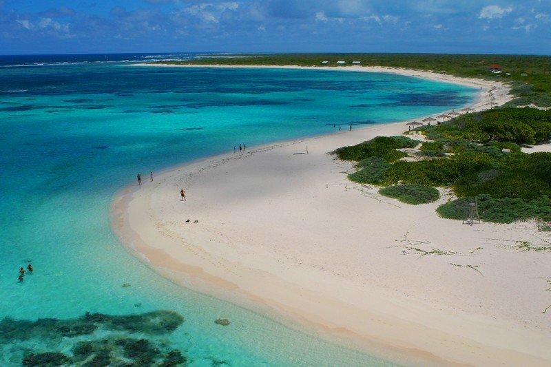 The coast curves sinuously around the sea at the tropical paradise of Anegada