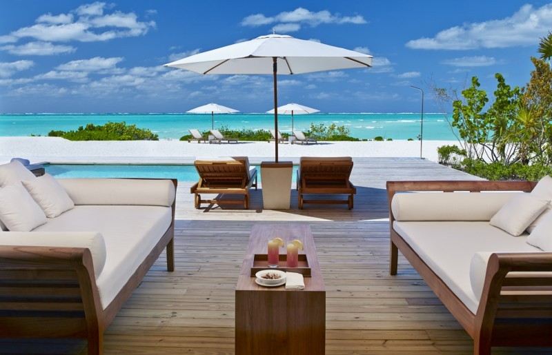 Sun Deck and loungers at Como Parrot Cay luxury resort in Turks and Caicos looking across lots of blue Caribbean Sea