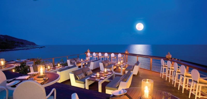 The Rock Pool Restaurant looking over the ocean and lambent with moonlight