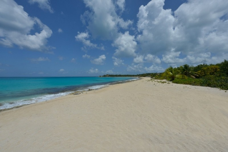 St Martin Beaches - Plum Bay exposes it's soft, powdery white sand to the blue sky overhead
