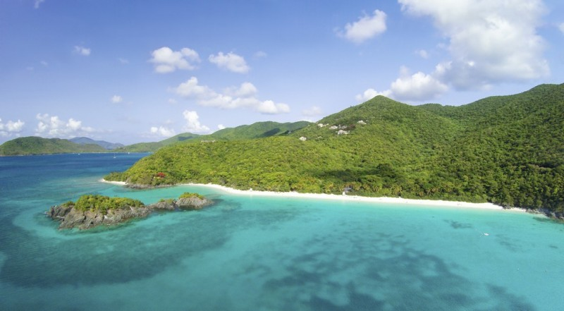 Aerial view of densly forested hills over-looking transparent blue waters in the US Virgin Islands