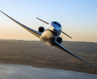 Gulfstream G650 Heavy Jet banks majestically over a tropical landscape