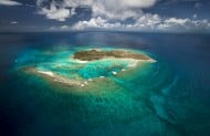 Aerial View of Necker Island - a green watered atoll surrounded by deep blue sea