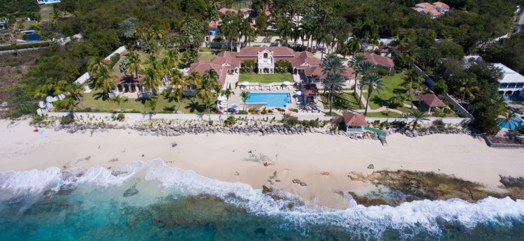 Aerial view of Chateau des palmiers sitting right on the white sandy beach beofre the sea