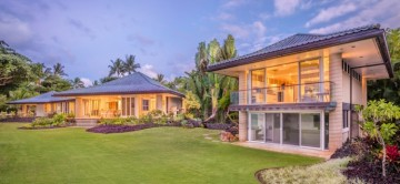 Anini Beach Front Home by twilight & the beautiful manicured